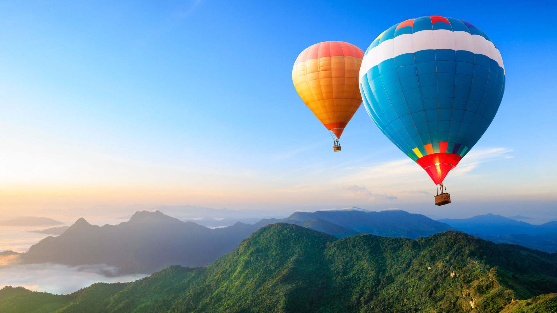 colorful-hot-air-balloons-flying-over-the-mountain_890